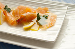 Smoked salmon marinated on oil Stock Image