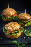 Smoked salmon mini burgers Royalty Free Stock Image
