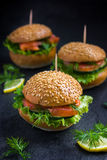 Smoked salmon mini burgers Stock Photo