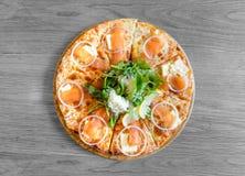 Smoked salmon pizza Stock Image