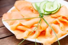 Smoked salmon on a plate Stock Images
