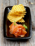 Smoked Salmon and Potato Chips Royalty Free Stock Photos