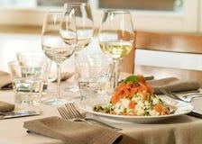 Smoked salmon and potato salad. Smocked salmon and potato salad in stylish restaurant dinner setting Royalty Free Stock Photography