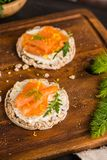 Smoked salmon on rice bread toasts Royalty Free Stock Photos