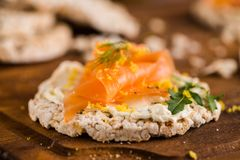 Smoked salmon on rice bread toasts Stock Photography