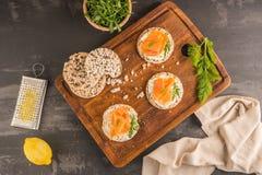 Smoked salmon on rice bread toasts Royalty Free Stock Image