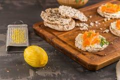 Smoked salmon on rice bread toasts Stock Photo