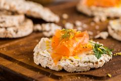 Smoked salmon on rice bread toasts Stock Photos
