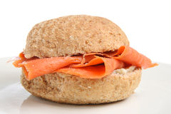 Smoked Salmon Roll. Smoked salmon in a wholemeal roll with freshly ground pepper. Shallow DoF, focus in centre of frame Royalty Free Stock Photo