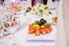 Smoked salmon roll with cheese. Banquet in a luxurious restaurant. royalty free stock photos