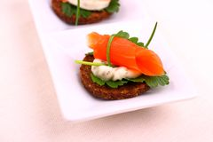 Smoked salmon roll on pumpernickel bread with remoulade Stock Images