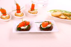 Smoked salmon roll on pumpernickel bread with remoulade Royalty Free Stock Photo