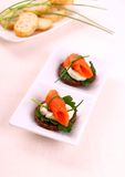 Smoked salmon roll on pumpernickel bread and remoulade Stock Photo