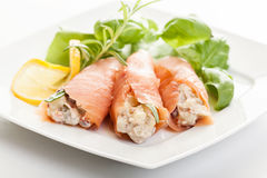 Smoked salmon roll with vegetable salad Royalty Free Stock Images