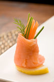 Smoked Salmon rolls with tomatoes Royalty Free Stock Images