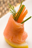 Smoked Salmon rolls with tomatoes Stock Photography