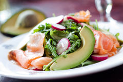 Smoked Salmon Salad. Smoked Salmon, avocados, arugula and radishes tossed in a dijon and lemon dressing to make the perfect seafood salad stock images
