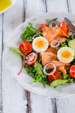 Smoked salmon salad with greens Stock Image