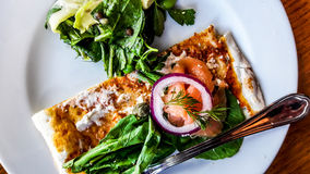Smoked Salmon Salad with onions and greens on cream cheese and crispy bread. Royalty Free Stock Image