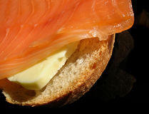 Smoked salmon sandwich close-up. Close-up of salmon sandwich with butter stock photos