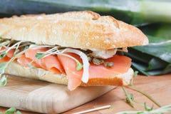 Smoked salmon sandwich on cutting board stock photos