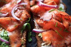 Smoked salmon sandwich on dark bread Stock Photo