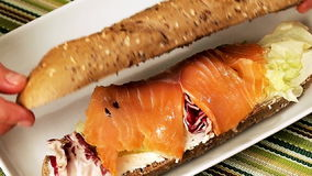 Smoked salmon sandwich stock video