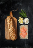 Smoked salmon sandwich recipe - ingredients on black Royalty Free Stock Photos