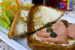 Smoked salmon sandwich Royalty Free Stock Images