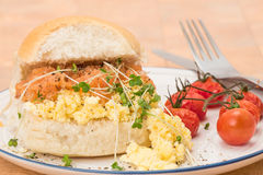 Smoked salmon and scrambled egg in a bread roll Stock Image