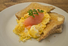 Smoked salmon and scrambled egg Royalty Free Stock Images