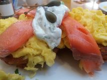 Smoked Salmon with Scrambled eggs capers and cream cheese Stock Photo