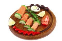 Smoked salmon slice on wood Stock Image