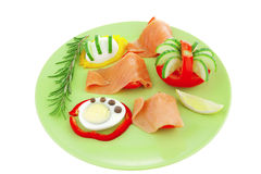 Smoked salmon slices on green Stock Image