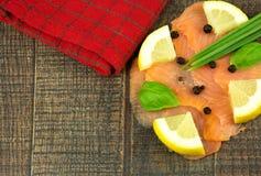 Smoked salmon slices with lemon Royalty Free Stock Photo