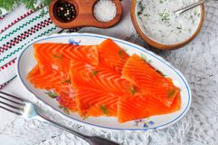 Smoked salmon slices with sour cream and dill. rustic style. Royalty Free Stock Photography