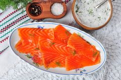 Smoked salmon slices with sour cream and dill. rustic style. Royalty Free Stock Photo