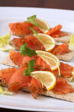 Smoked salmon snacks Stock Image