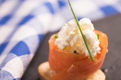 Smoked Salmon and soft chees canapes appetizers. On a black plate Royalty Free Stock Images