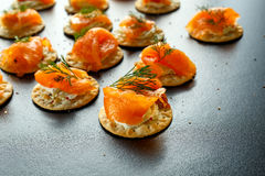 Smoked Salmon and soft chees canapes appetizers with chives on stone table Royalty Free Stock Photo