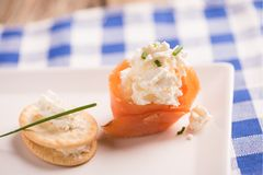Smoked Salmon and soft chees canapes appetizers. On a plate Stock Image