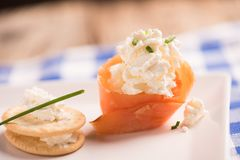 Smoked Salmon and soft chees canapes appetizers. On a plate Stock Photos