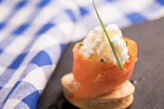 Smoked Salmon and soft chees canapes appetizers. On a black plate Royalty Free Stock Photo