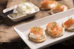 Smoked Salmon and soft chees canapes appetizers. On a plate Stock Photography