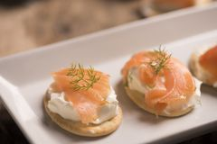 Smoked Salmon and soft chees canapes appetizers. On a plate Royalty Free Stock Image