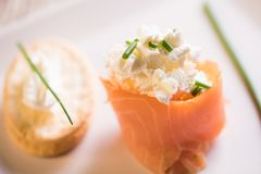 Smoked Salmon and soft chees canapes appetizers. On a plate Royalty Free Stock Photography