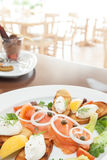Smoked salmon with soft cheese and chive. Smoked salmon with soft cheese, chive, bread and onions stock image
