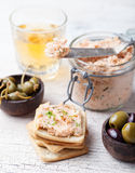 Smoked salmon and soft cheese spread, mousse, pate in a jar with crackers and capers on a wooden background Stock Images