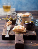 Smoked salmon and soft cheese spread, mousse, pate in a jar with crackers and capers on a wooden background Stock Photos