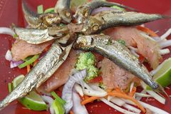 Smoked salmon and sprats. With vegetables and lemon Royalty Free Stock Photos